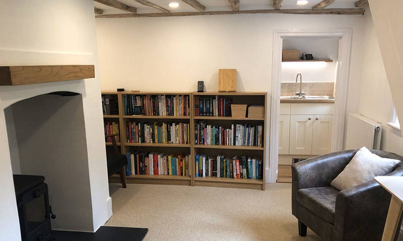 A new room, with bookcases, carpets and all is clean.