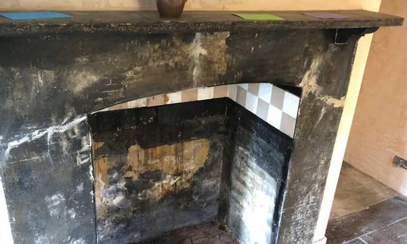 Blackened fireplace.