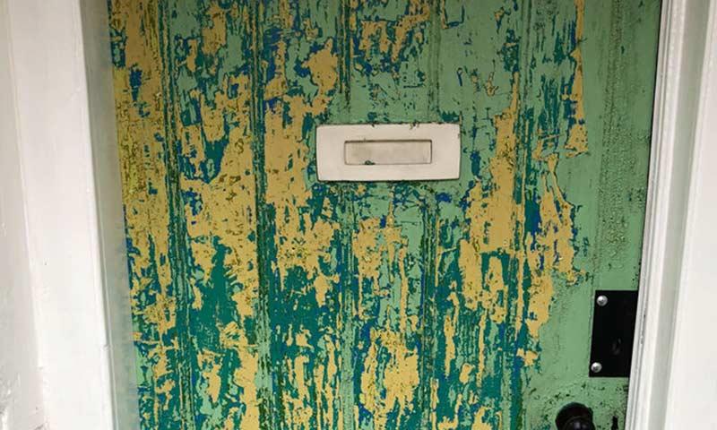 Front door, paint peeling.