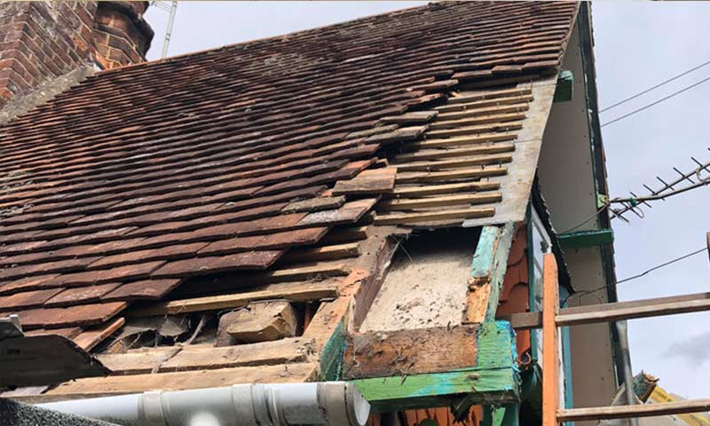 Roof with tiles missing.