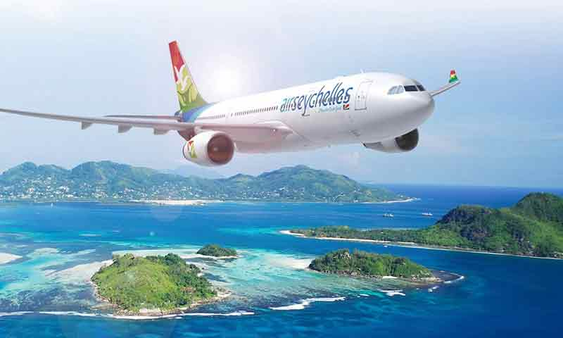 Photo of an Air Seychelles plane flying over islands.